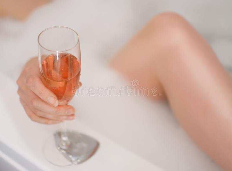 Woman with glass of wine. stock photography
