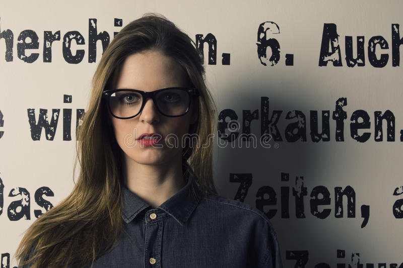 Skeptical Woman With Glasses Royalty Free Stock Photography