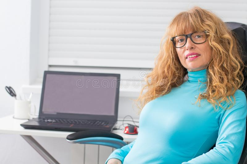 Woman with glasses and computer stock images