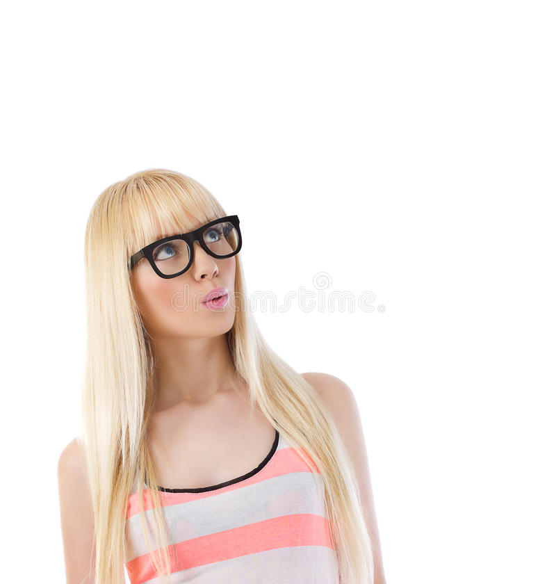 Woman In Glasses Looking Up At Copyspace Stock Photo