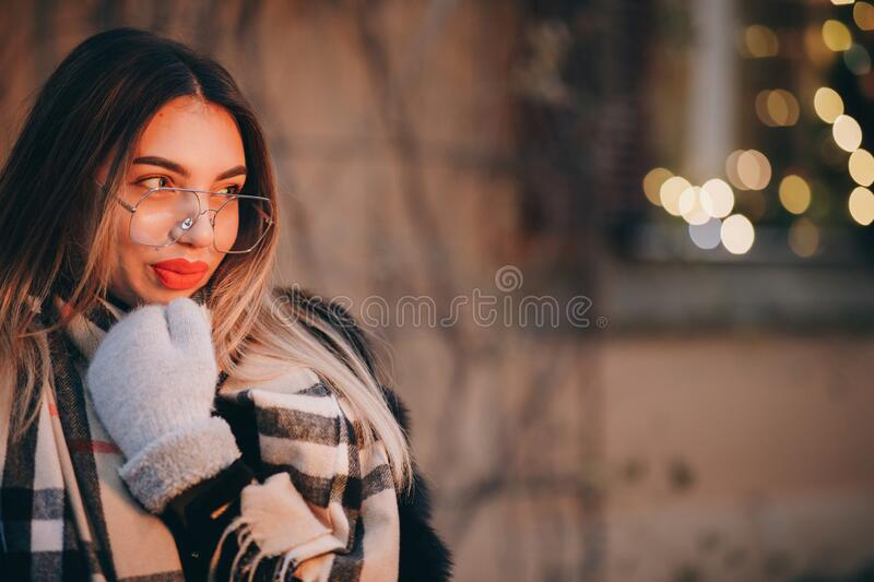 Woman with glasses poses in city center Beautiful hair attractive smile girl. Close up shot Woman with glasses during stock photos