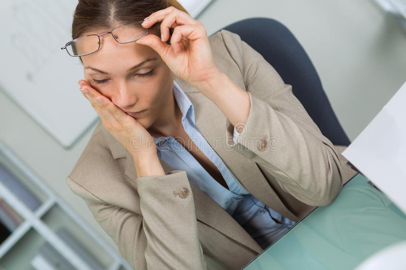 Woman with glasses suffering from eyestrain royalty free stock photos