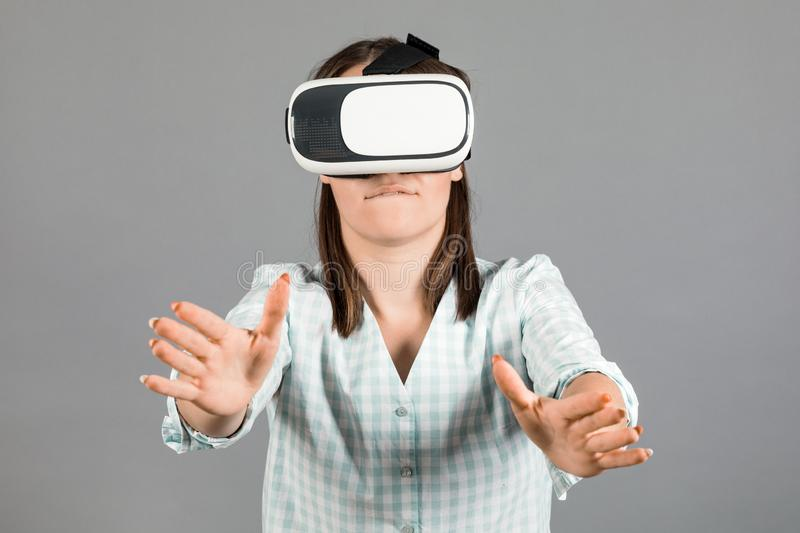 Woman with glasses of virtual reality. Future technology concept.  On a gray background stock photos