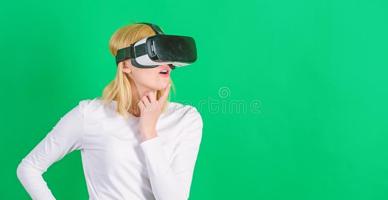 The woman with glasses of virtual reality. Woman using VR device. Cheerful smiling woman looking in VR glasses royalty free stock photos