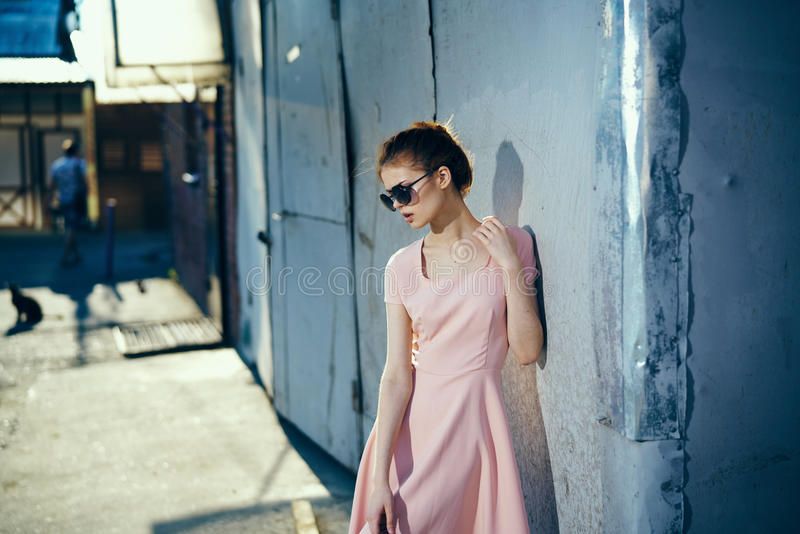 Woman in glasses, woman on old wall background royalty free stock image