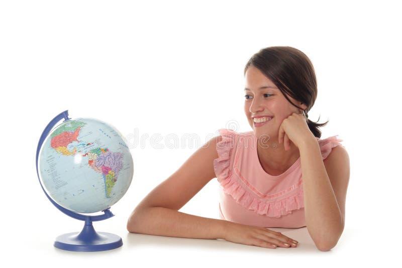 Woman with globe stock photos