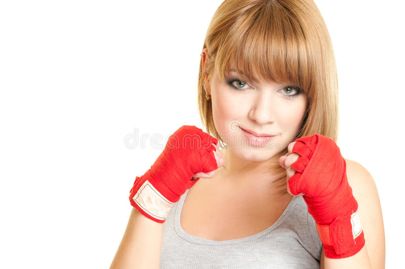 Woman in a glove. Portrait of beautiful red-haired girl in a glove Kickboxing royalty free stock photo