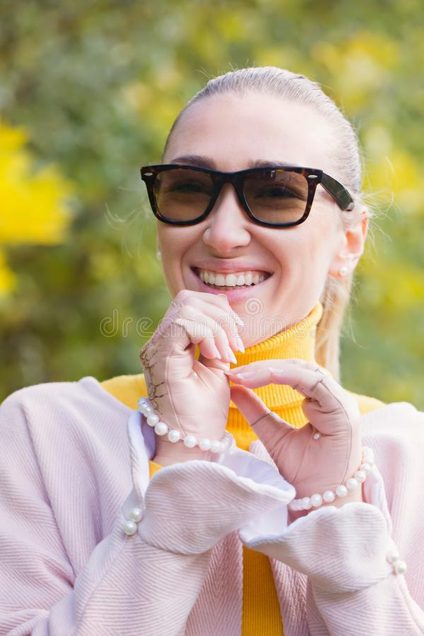 Woman in gloves and sunglasses stock photo