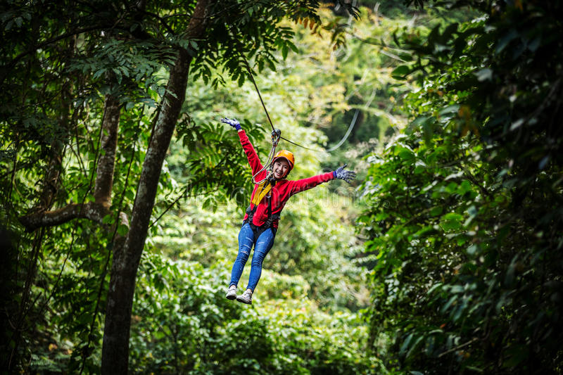 Woman going on a jungle zip line adventure, asia.  royalty free stock photos