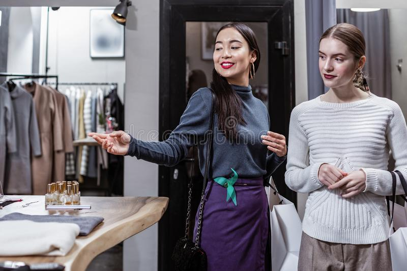 Woman going shopping with her best friend stock images