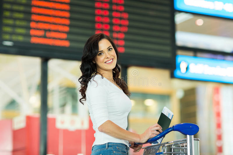 Woman going trip. Attractive young woman going on a trip by air royalty free stock photo