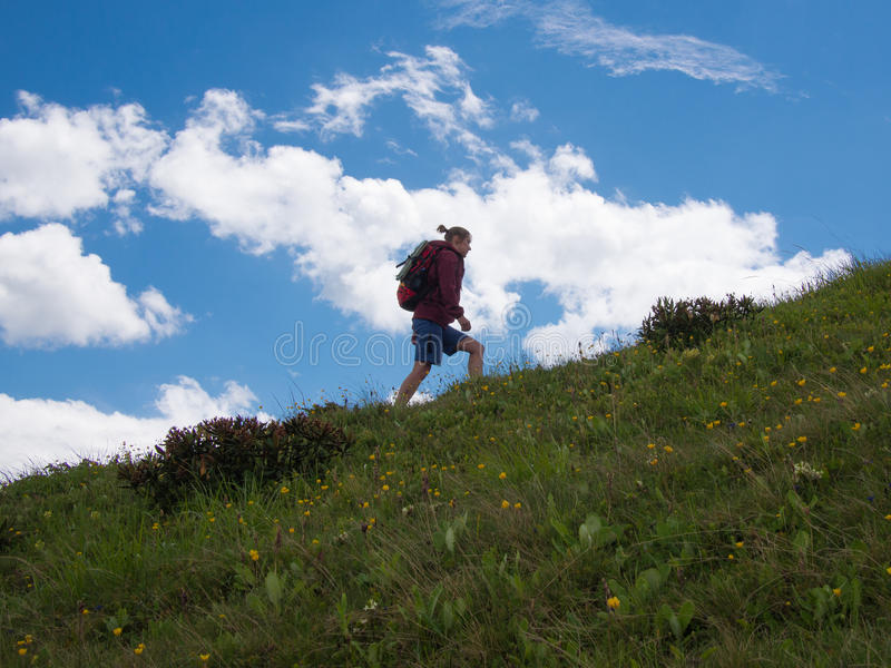 Woman going up the hill stock images