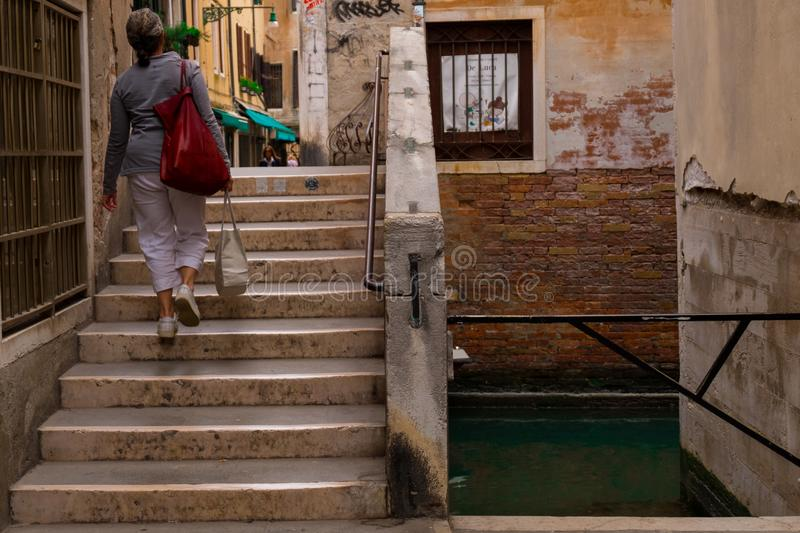 Stairs from a venetian canal royalty free stock image