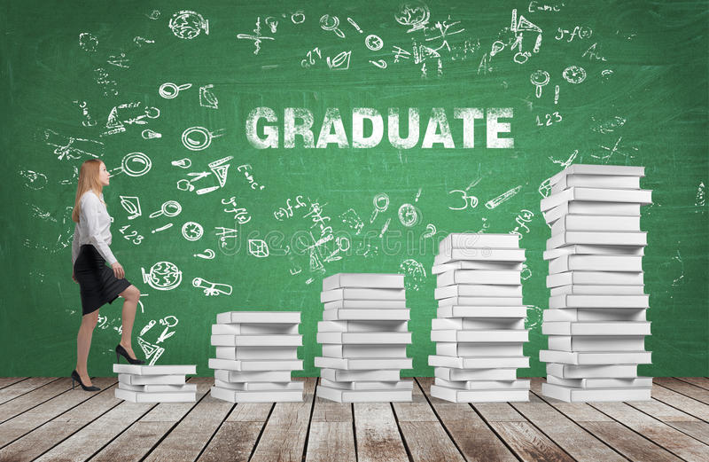 A woman is going up using a stairs which are made of white books. The word graduate is on the green chalkboard. royalty free stock photo