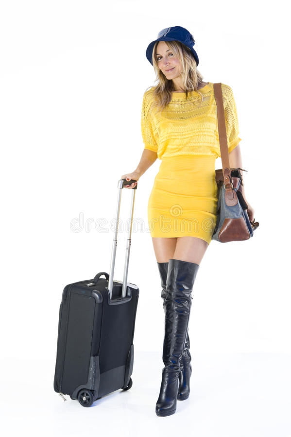 Woman going on vacation. Happy woman going on vacation with camera and her suitcase over a white background royalty free stock image