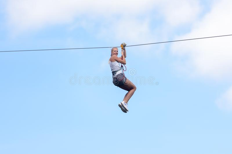 Woman going on zipline adventure. Woman going on a zipline adventure royalty free stock photos