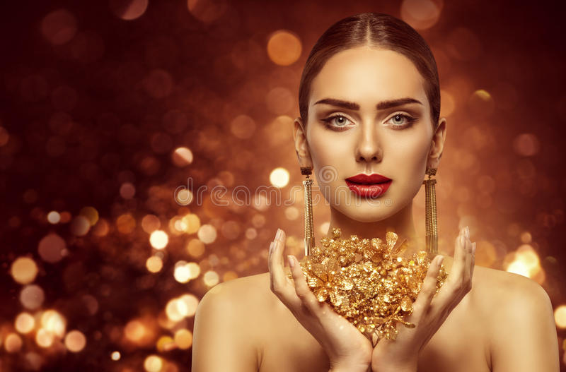Woman Gold Beauty, Fashion Model Holding Golden Jewelry stock image