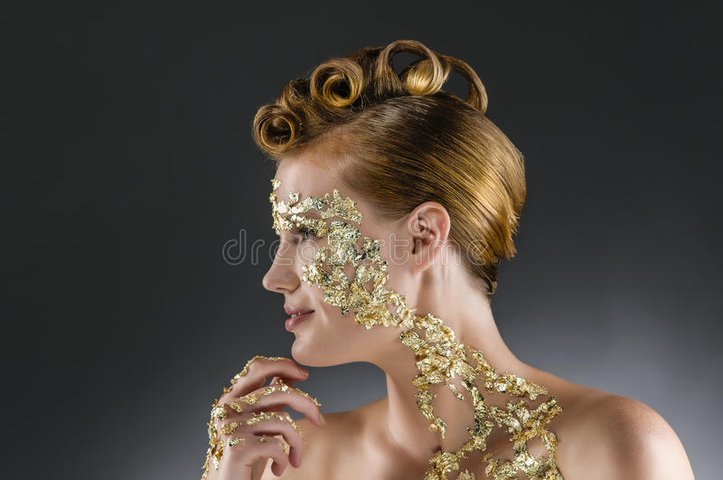Woman with gold makeup stock photography