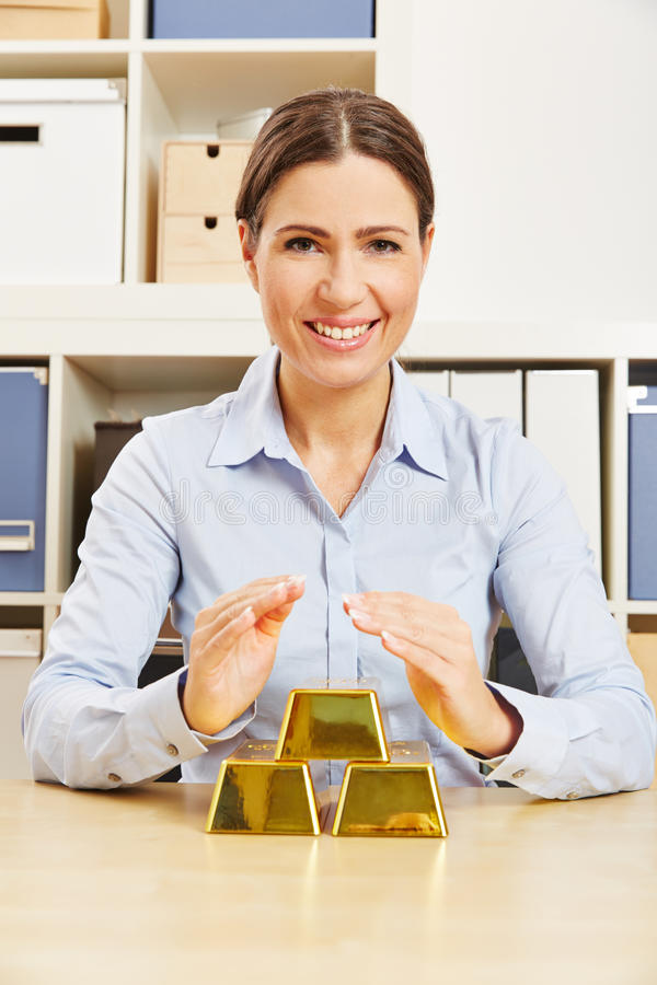 Woman with gold money as security royalty free stock photos