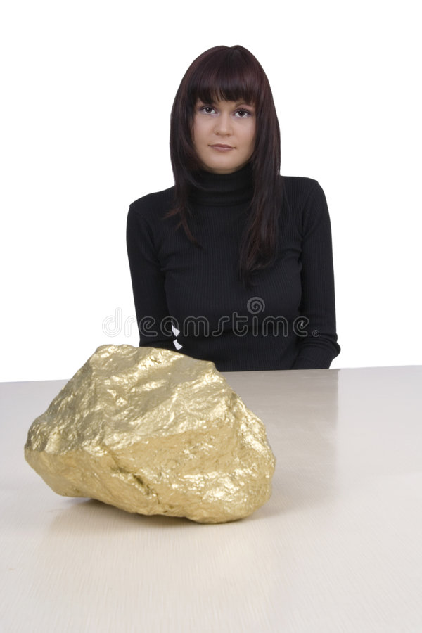 Woman with a gold nugget stock photography