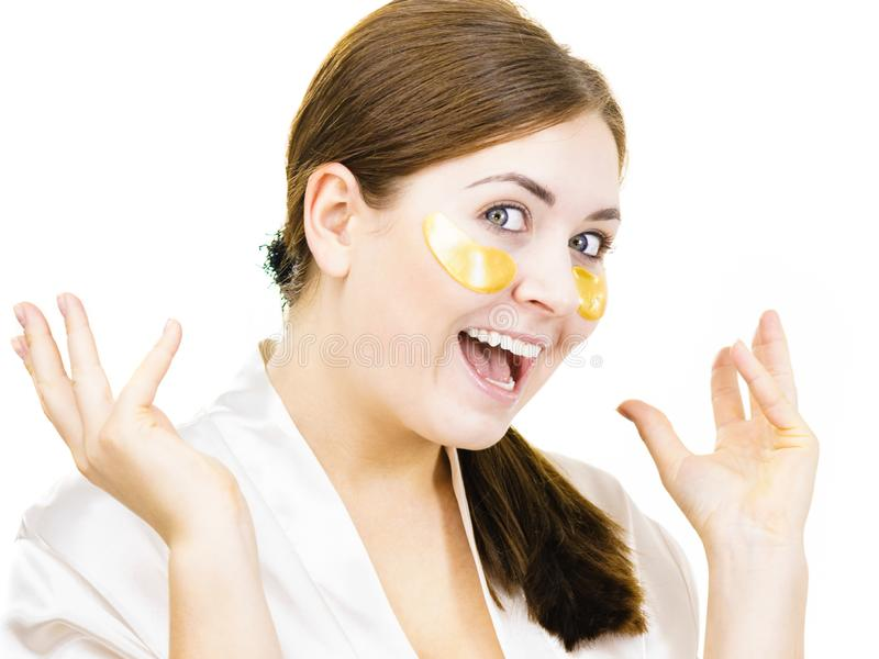 Woman with gold patches under eyes stock images
