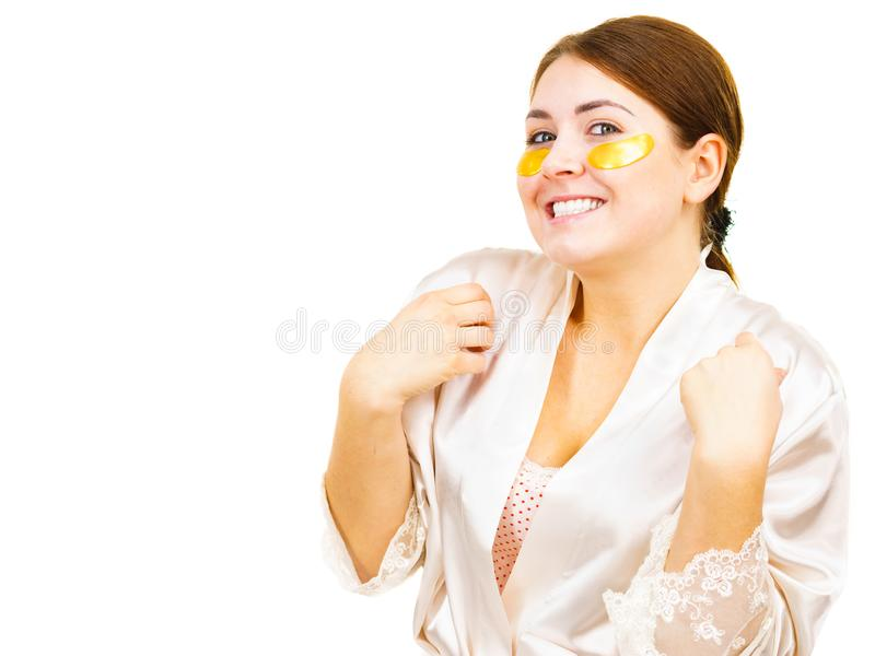Woman with gold patches under eyes royalty free stock image