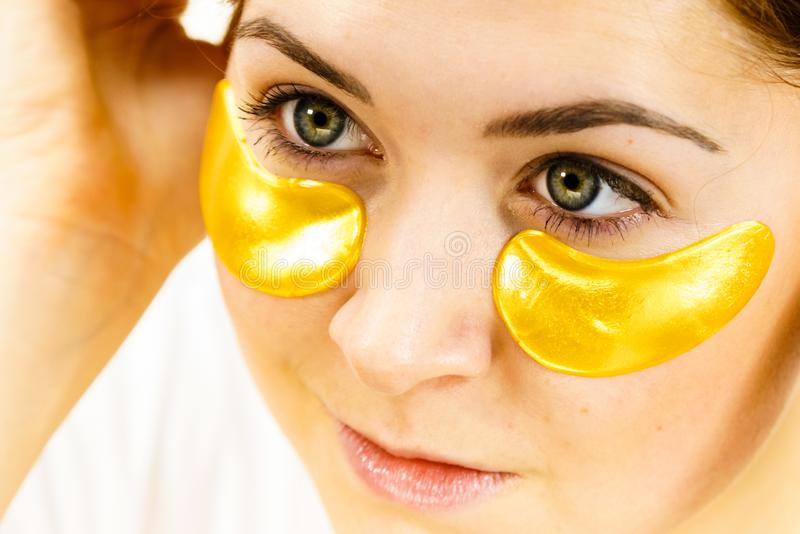 Woman with gold patches under eyes royalty free stock photo