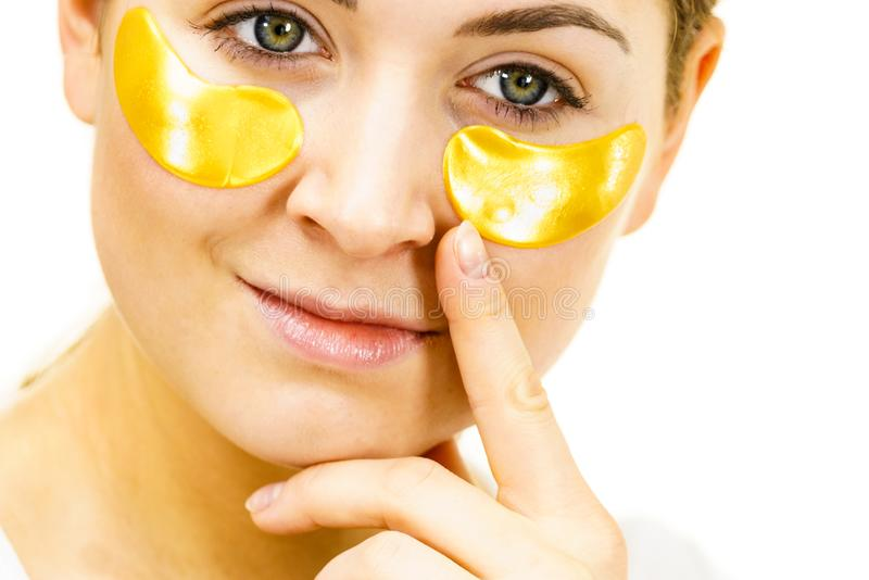 Woman with gold patches under eyes stock image