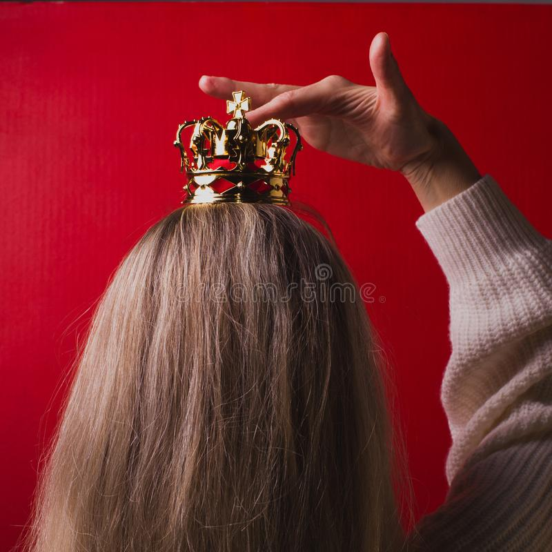 Woman with a golden crown, close-up stock photography