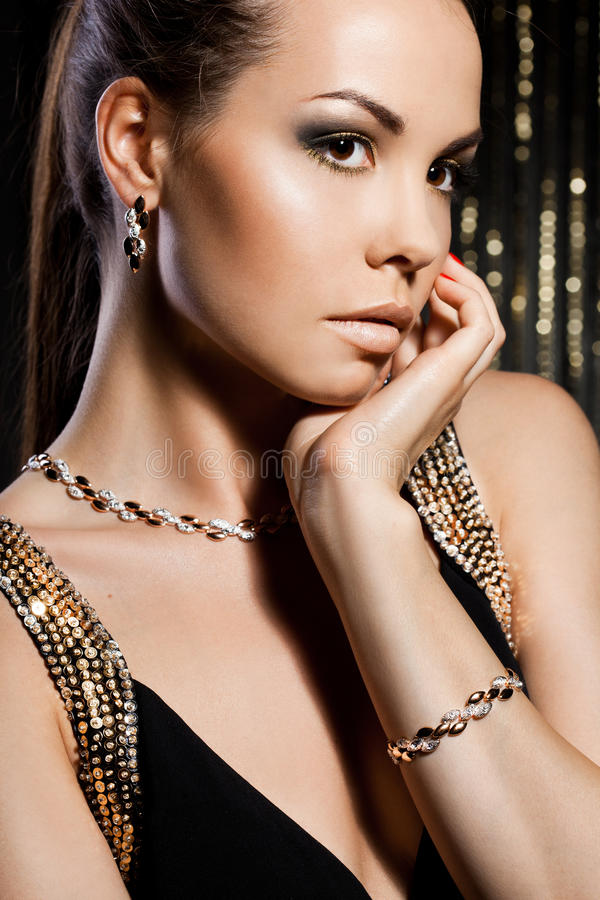 Woman with golden jewelry stock photos