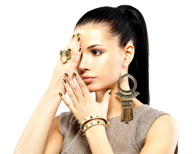 Download Woman With Golden Nails And Beautiful Gold Jewelry Stock Image - Image: 29260253