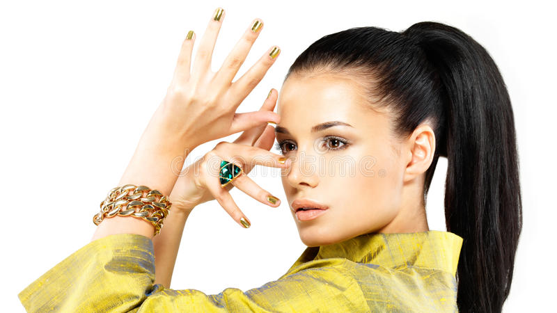 Download Woman With Golden Nails And Precious Stone Emerald Royalty Free Stock Photos - Image: 29260298
