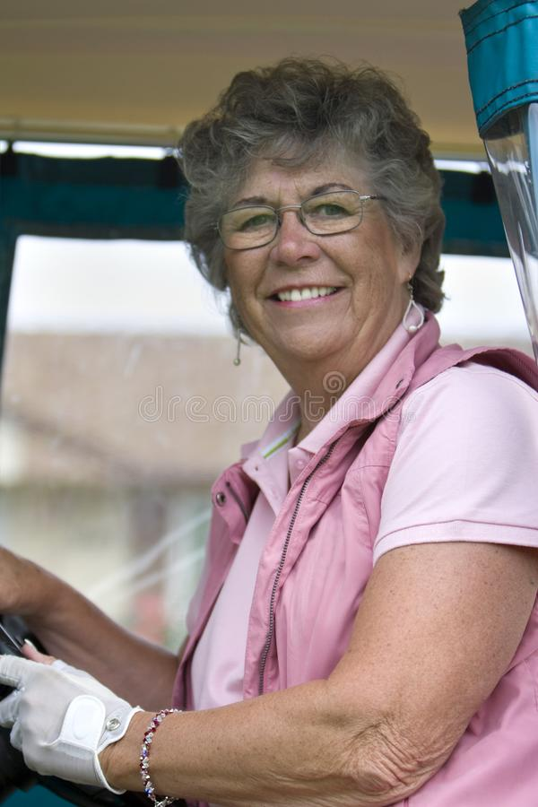 Woman in Golf Cart royalty free stock image