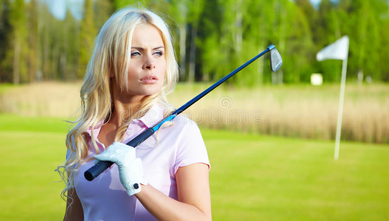 Woman with golf equipment. Young blonde woman with golf equipment stock images