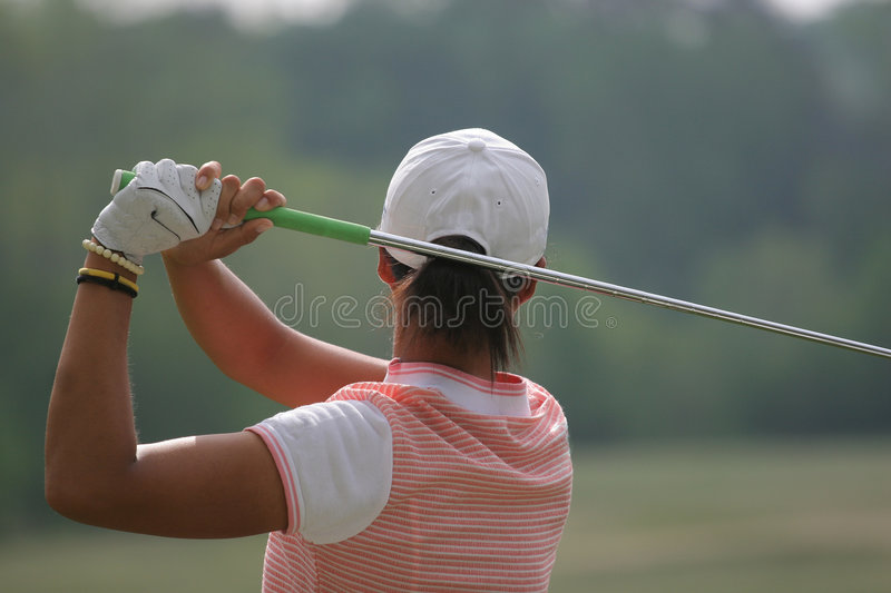 Woman golf swing stock photography