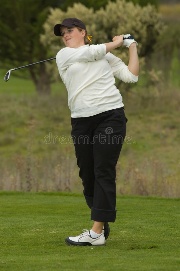 Download Woman golfer swinging club stock image. Image of collegiate - 7004537