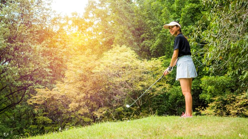 Woman golferson the green and keep golf course in the summer for relax time royalty free stock photo