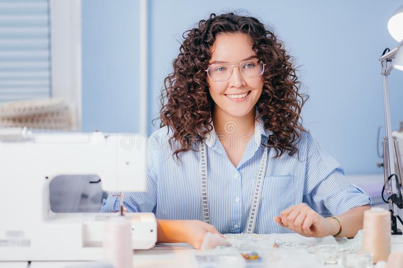 Woman is good at embroidery. favourite deal. hobby. Good mood. happy seamstress royalty free stock photography