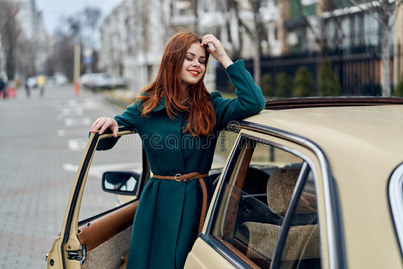 The woman got out of the car, the woman at the car stock photo