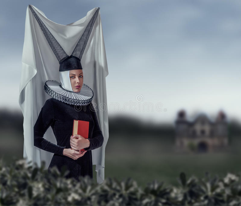 Woman in a gothic clothing. Fashion woman in a medieval gothic style clothing stock photo