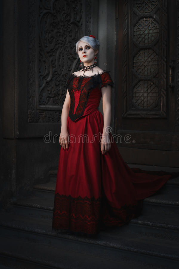 Woman in a gothic image in a fairy-tale castle. Woman in a gothic image in a fairy-tale castle, retro style royalty free stock image