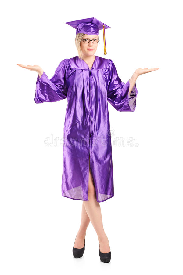 Woman in graduation gown gesturing uncertainty stock images