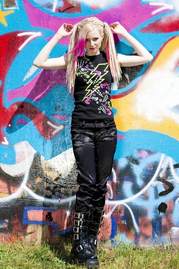 Woman at graffiti wall stock photos