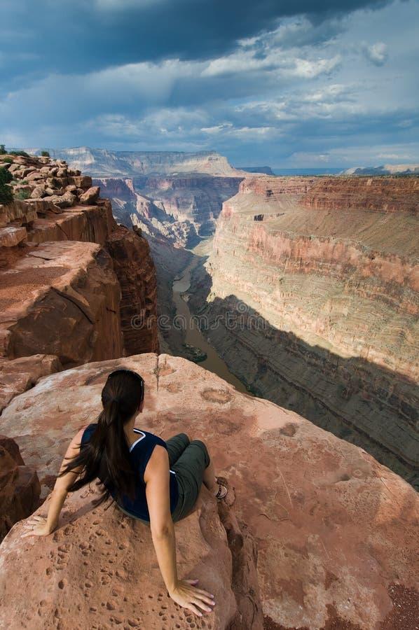 Woman and Grand Canyon at Toroweap royalty free stock photo
