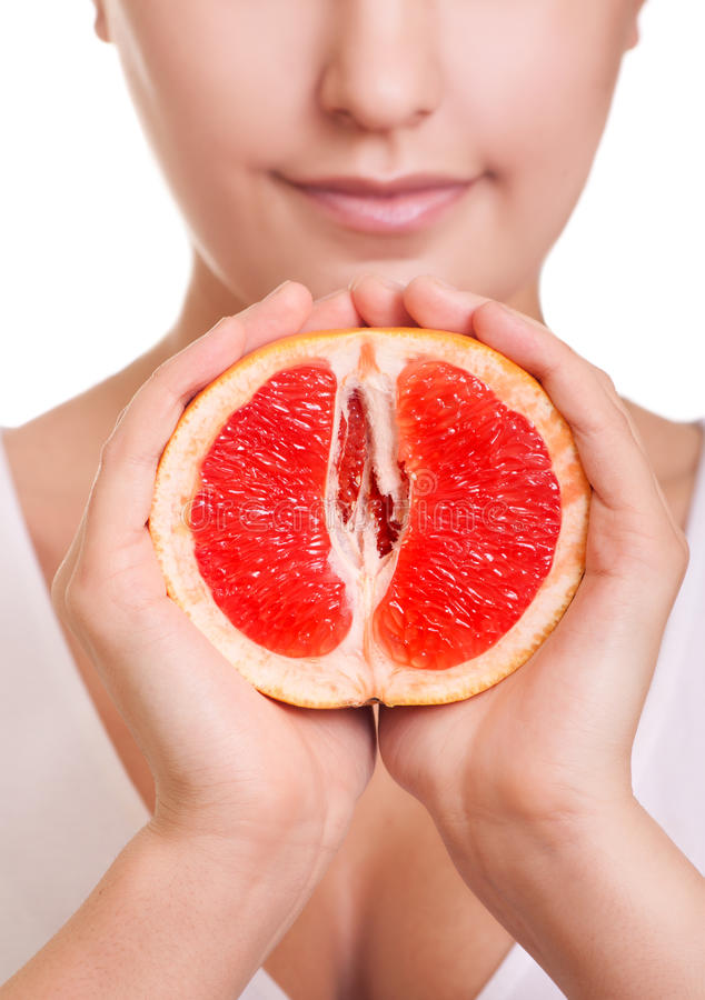 Woman with grapefruit in hands close-up royalty free stock images