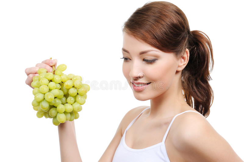 Woman with grapes. Beautiful woman with bunch of grapes - isolated on white background stock photography