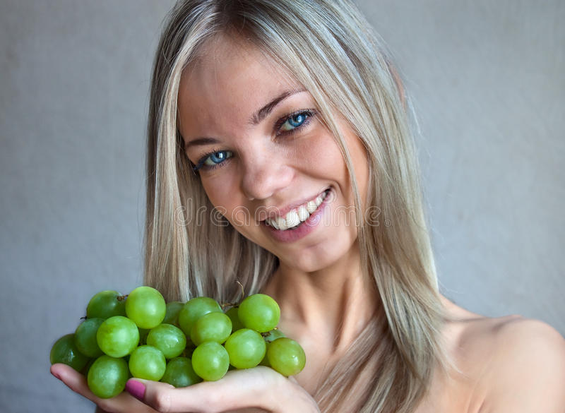 The woman with grapes stock images