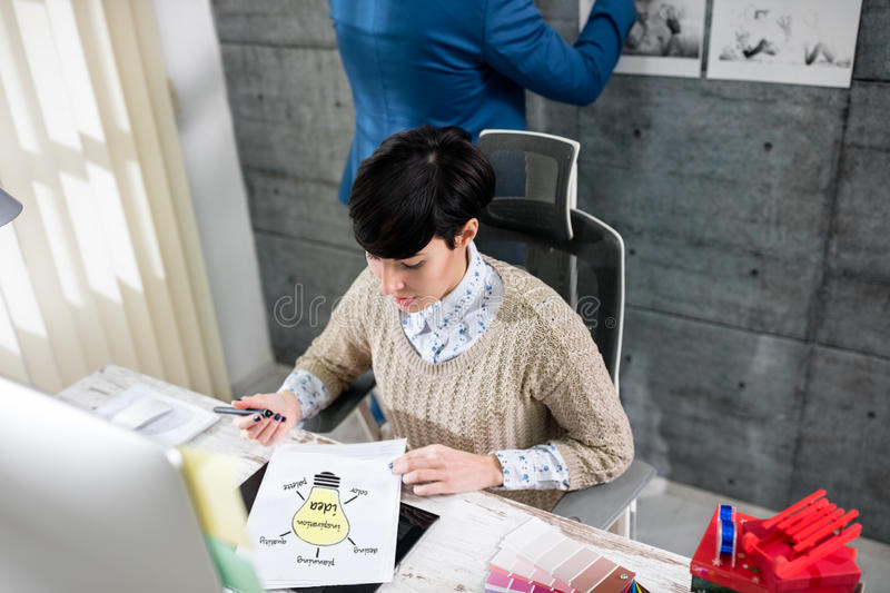 Woman graphic designers working. In office stock photos