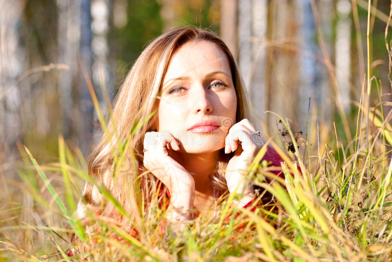 Woman on the grass stock photography