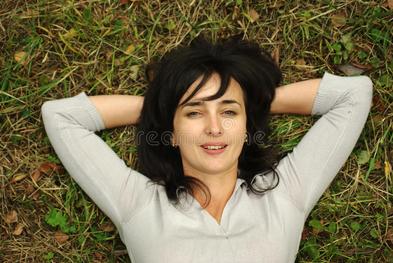 Woman on the grass royalty free stock image